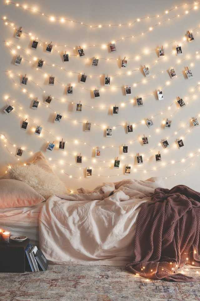 7 magical things you can do with fairy lights grazia get some wooden pegs to attach your favourite pictures to the string ive done this before and blue tac keeps the lights on your wall aloadofball Choice Image
