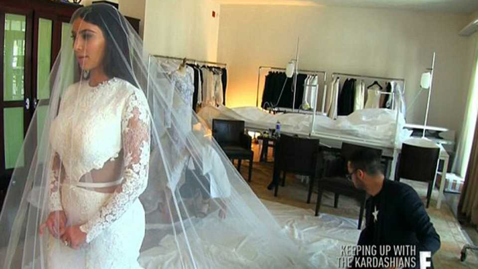 Kim kardashians wedding dress fitting has aired on keeping up kim kardashian tied the knot to mr kanye west today in the full givenchy works a white givenchy gown veil and accessories junglespirit Gallery