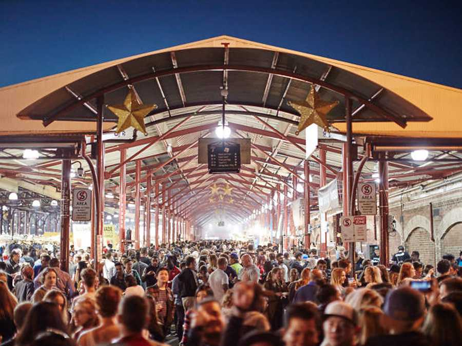 Experience the iconic Queen Victoria Market at night